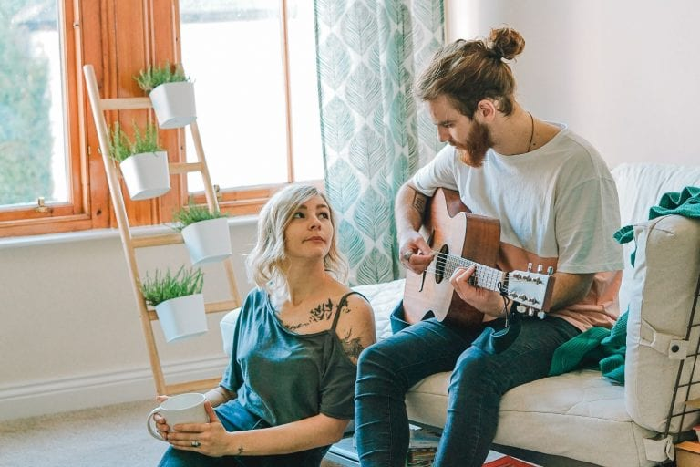 Couple playing guitar; bamboo plant stand