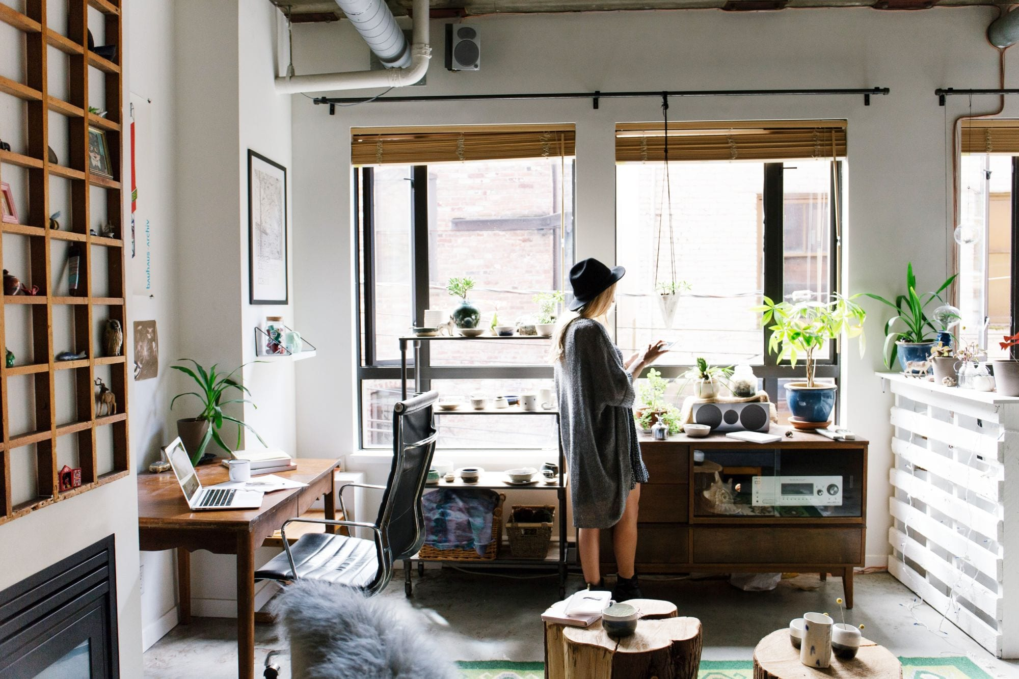 Woman in home office; bamboo cabinets