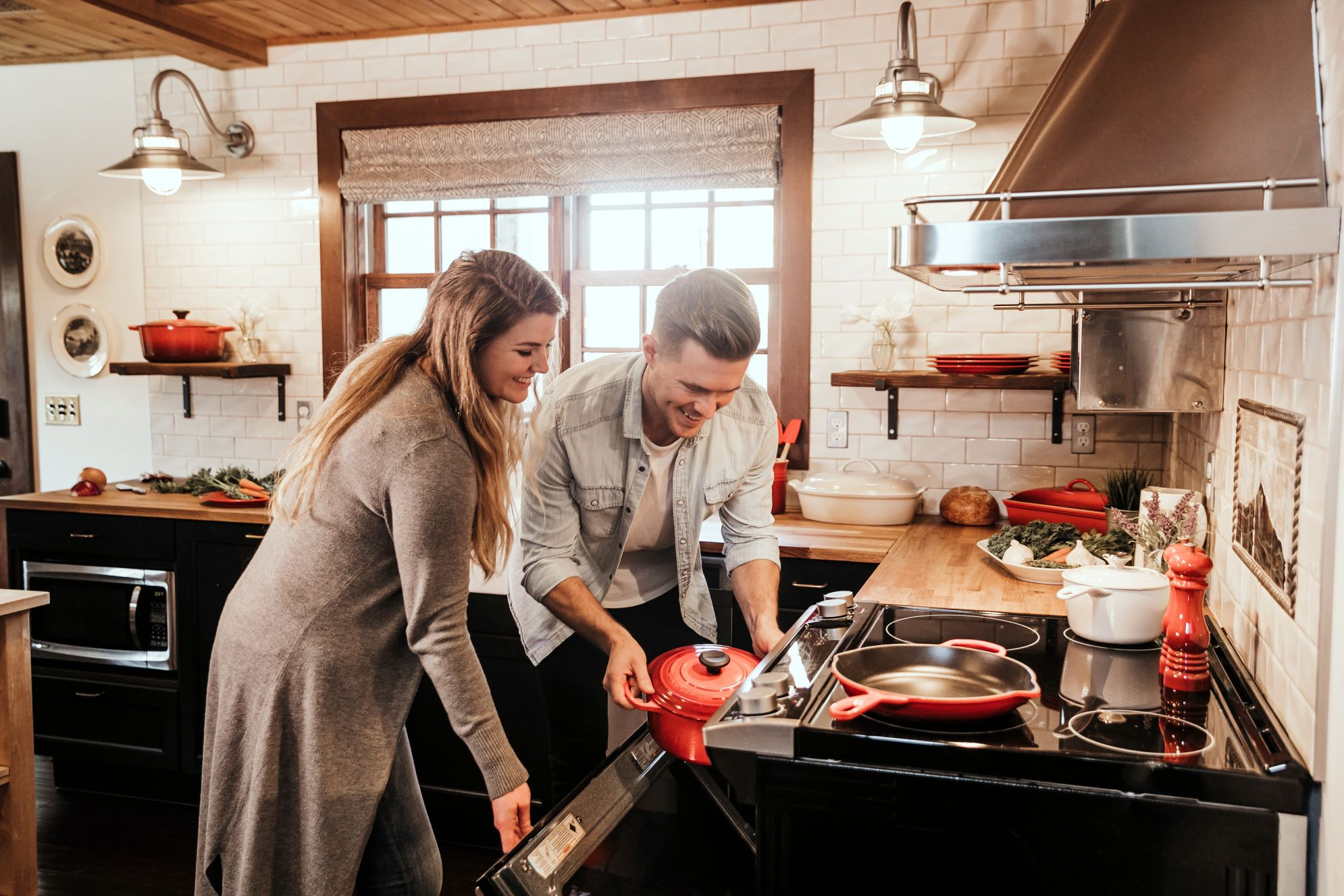 Couple baking in kitchen; bamboo countertops and bamboo butcher blocks