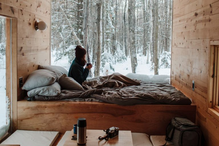 Person in bed looking outside at snow; bamboo blankets