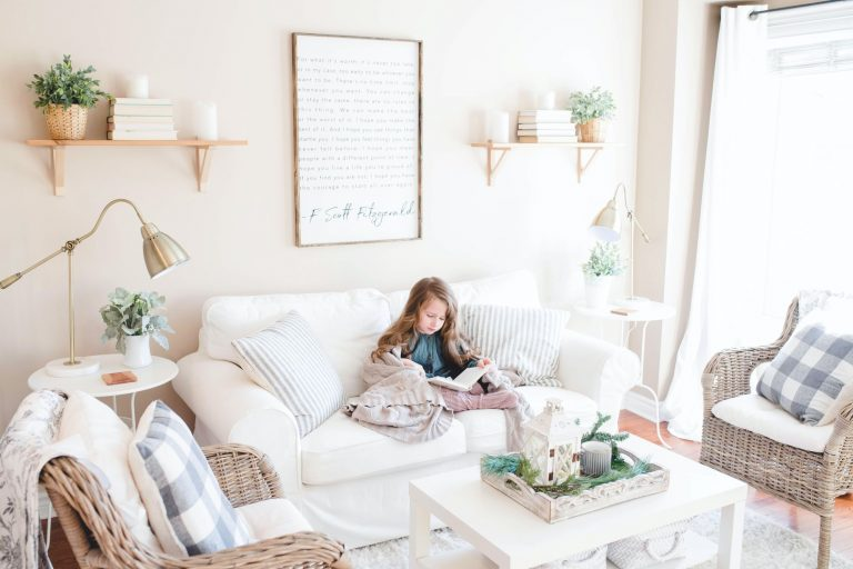Girl reading on couch; bamboo curtains