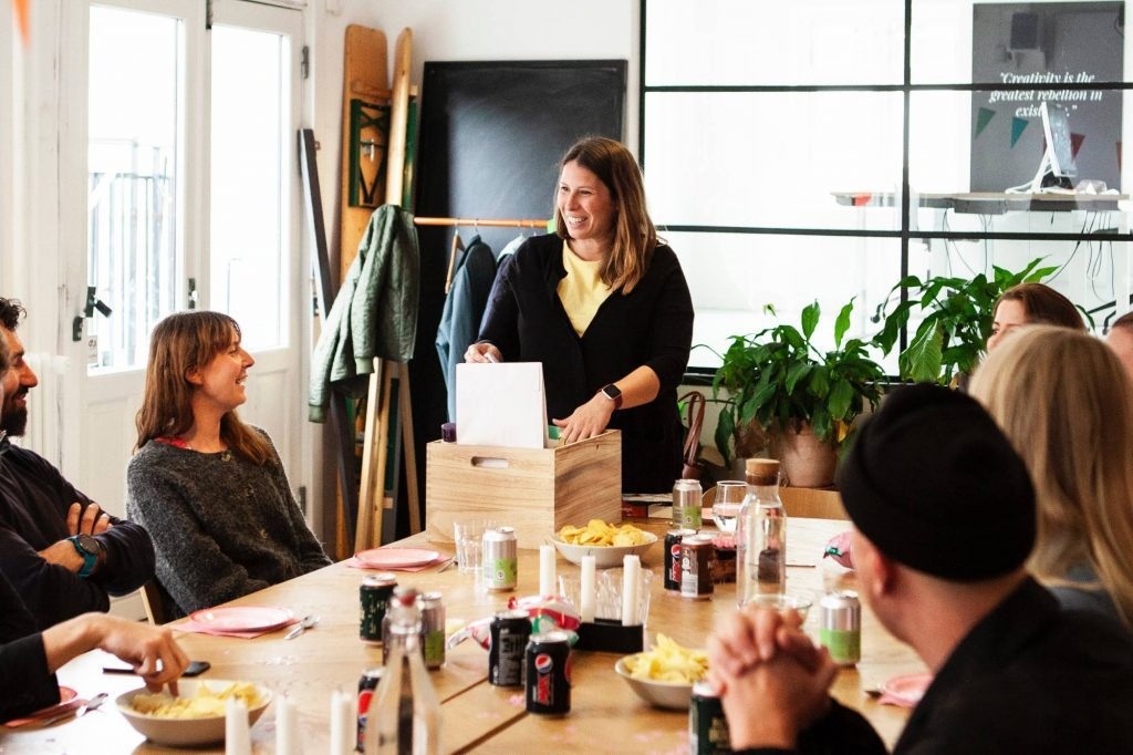 Coworkers opening gifts at office party; nut free gifts for office